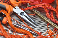 Pliers with electrical component kit Royalty Free Stock Photo