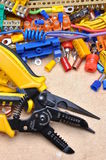 Pliers and electrical components Stock Photos