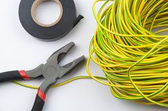 Pliers electrical tape and bundle of wires on close-up stock photos