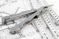 Pliers, folding ruler and architectural plan Royalty Free Stock Image