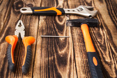 Pliers hammer nail adjustable wrench Royalty Free Stock Images