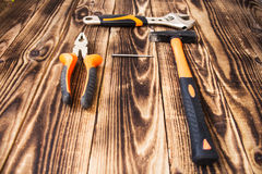 Pliers hammer nail adjustable wrench Stock Image
