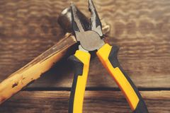 Pliers on hammer stock photography