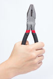 Pliers in hand Stock Photos