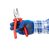 Pliers in hand Royalty Free Stock Photos