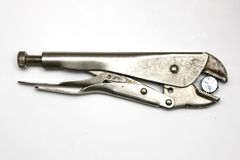 Pliers holding a bolt Stock Image