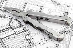 Pliers and house plan Royalty Free Stock Photography
