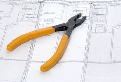 Pliers and house plan Stock Photography