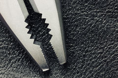 Pliers on a leather background. Close up Stock Photos