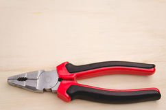Pliers on a light background Royalty Free Stock Photo