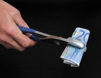 Pliers and Money Royalty Free Stock Images