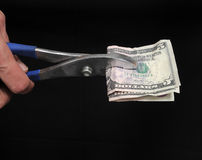 Pliers and Money Stock Photography