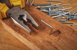 Pliers and nail Stock Photography