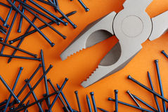 Pliers and nails Royalty Free Stock Photos
