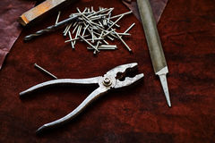 Pliers, nails, a file, an old rusty piece of metal Stock Photos