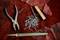 Pliers, nails, a file, an old rusty piece of metal Royalty Free Stock Photo
