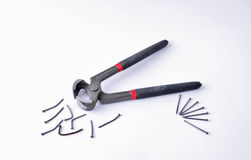 Pliers and nails Royalty Free Stock Image