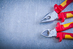 Pliers nippers on metallic background copyspace electricity conc Stock Photos