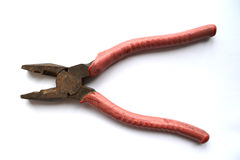 Pliers. Old pliers with red rubber handle Royalty Free Stock Images