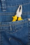 Pliers in pocket jeans Royalty Free Stock Images