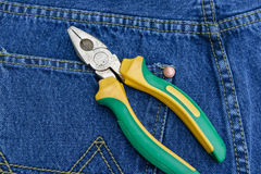 Pliers of pocket jeans. Pliers to repair a pocket of jeans stock photo