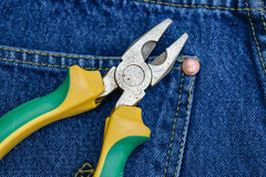 Pliers of pocket jeans. Pliers to repair a pocket of jeans stock image