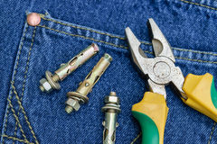 Pliers of pocket jeans. Pliers to repair a pocket of jeans stock photography