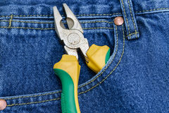 Pliers of pocket jeans. Pliers to repair a pocket of jeans royalty free stock image