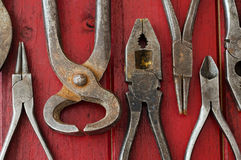 Pliers on Red Background Royalty Free Stock Photos