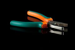 Pliers with rubbed grips. On black bachground Stock Images