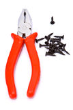 Pliers and screw. Isolated pliers with screws on white Royalty Free Stock Photography