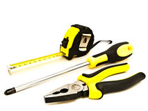 Pliers, screwdriver and meter Royalty Free Stock Images