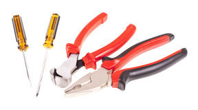 Pliers, screwdrivers and nippers on the white background Stock Image