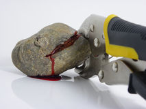 Pliers Squeezing Blood from a Stone Stock Image