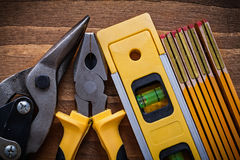 Pliers steel cutter construction level wooden meter top view ima Royalty Free Stock Photo