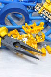 Pliers strippers and cables with electrical component kit Royalty Free Stock Images