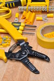 Pliers tool and electrical components Royalty Free Stock Photography