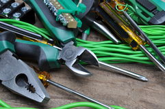 Pliers tools and component for electrical installation. On wooden board Stock Images