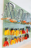 Pliers and tools hanging on wall Stock Photography