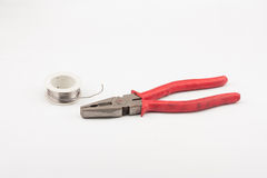 Pliers and wire Stock Photography