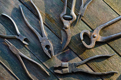 Pliers on Wood Stock Photo