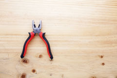 A pliers on a wood table Stock Photography