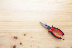 A pliers on a wood table Royalty Free Stock Photo