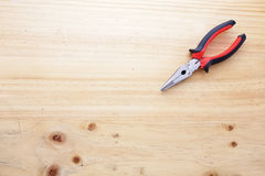 A pliers on a wood table Royalty Free Stock Photography