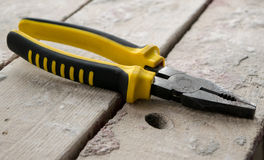 Pliers on wooden boards Royalty Free Stock Images