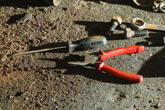 Pliers, wrench screwdriver on floor. Stock Photo