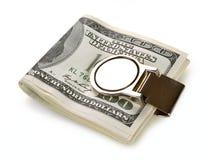 Plik 100 dolarów banknotów przymocowywa z pieniądze klamerką Fotografia Royalty Free
