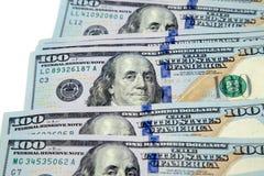 Plik sto dolarowych rachunków rozkładających jak fan Na biały tle bill tła dolara Amerykańscy dolary gotówka obraz royalty free