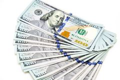 Plik sto dolarowych rachunków rozkładających jak fan Na biały tle bill tła dolara Amerykańscy dolary gotówka obrazy stock