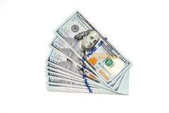 Plik sto dolarowych rachunków rozkładających jak fan Na biały tle bill tła dolara Amerykańscy dolary gotówka fotografia stock
